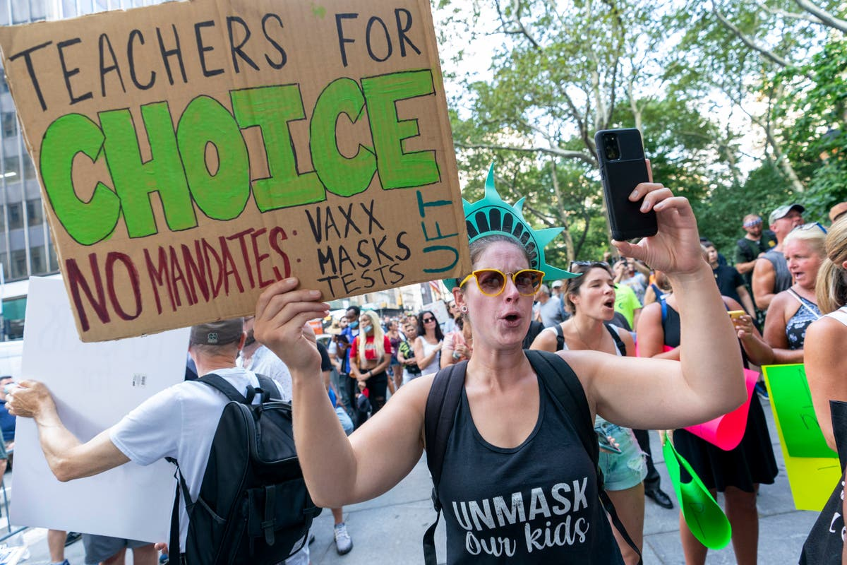 As districts insist on vaccines, some teachers push back
