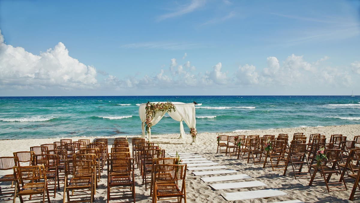 Newlyweds draft invoice to send to guests who did not show up to destination wedding