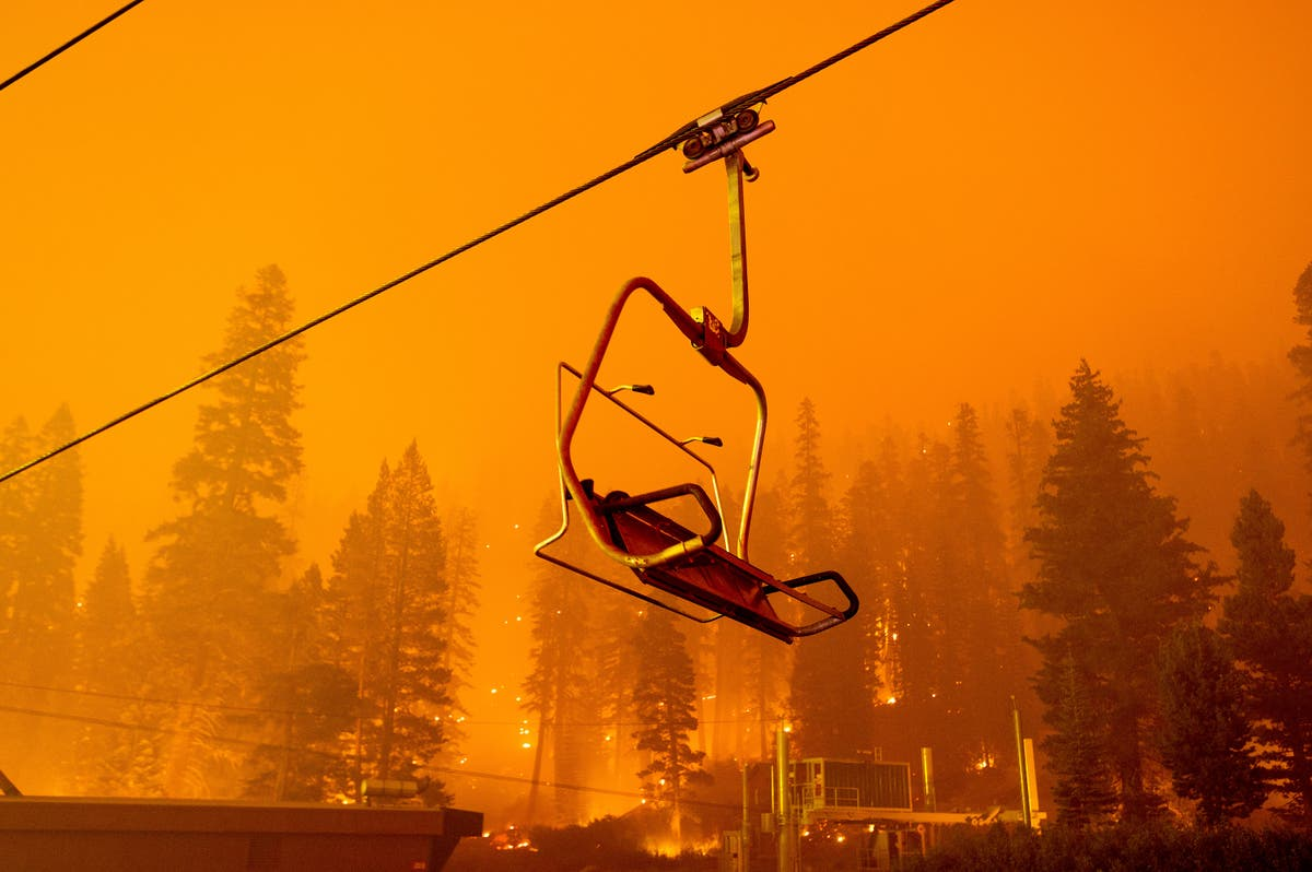 Thousands forced to flee Lake Tahoe tourist area as wildfire spreads rapidly