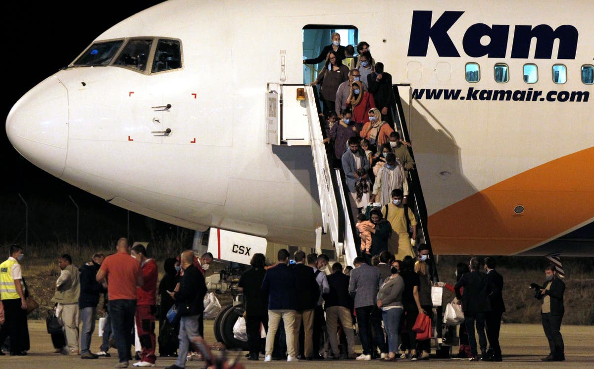 1st group of 149 Afghan evacuees arrives in North Macedonia
