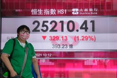 Asian shares mixed in muted trading amid virus worries