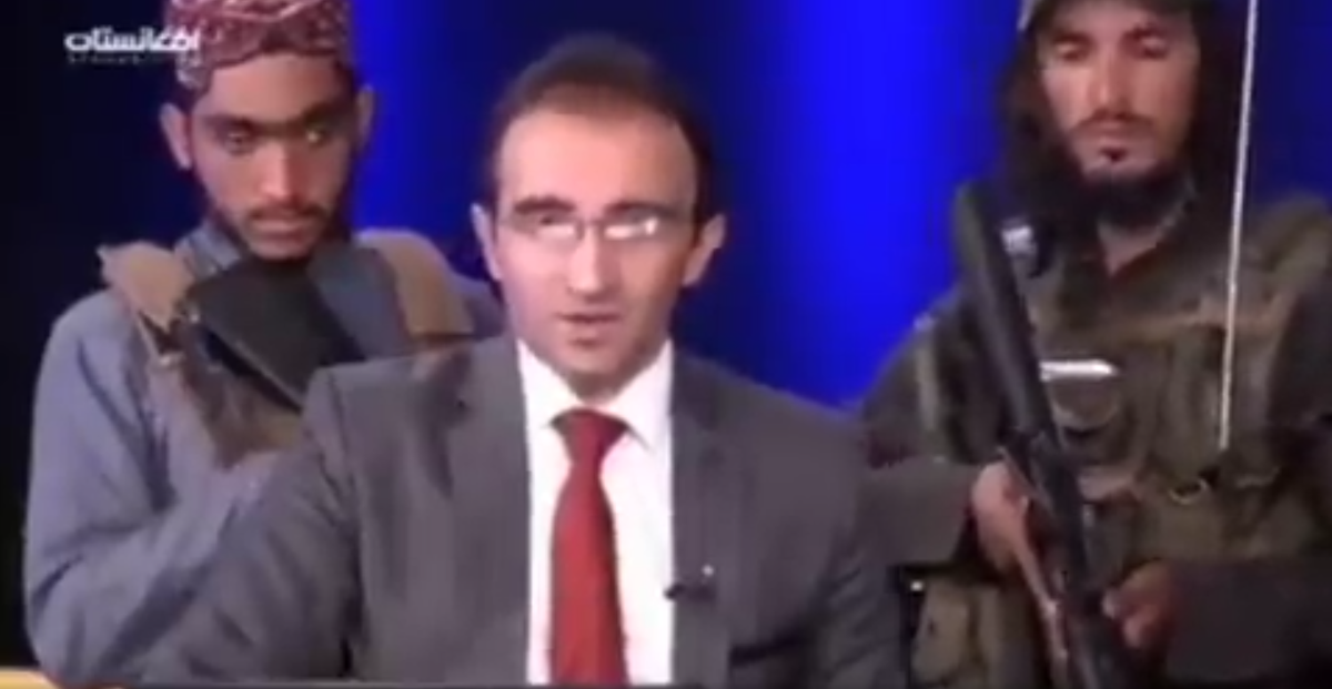 'Visibly petrified' Afghan TV anchor reads news while surrounded by gun-toting men