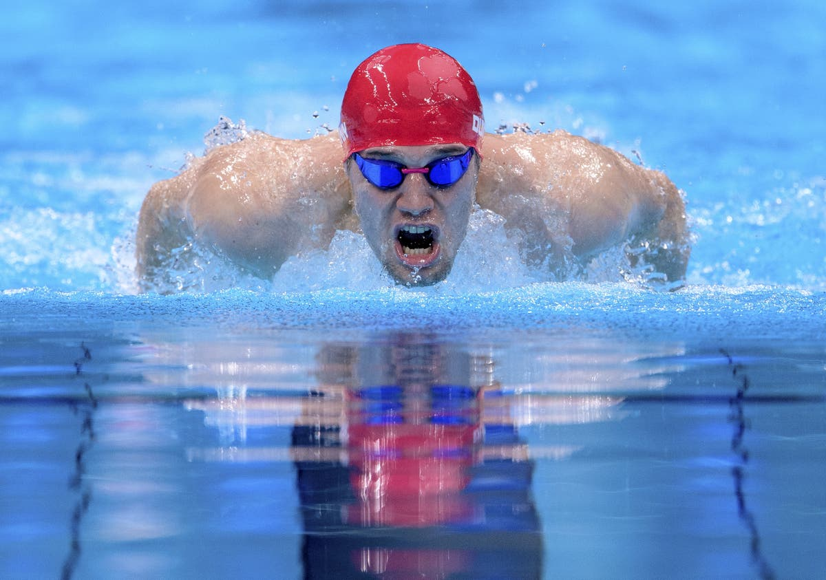 Reece Dunn claims third Games gold and world record in 200m individual medley