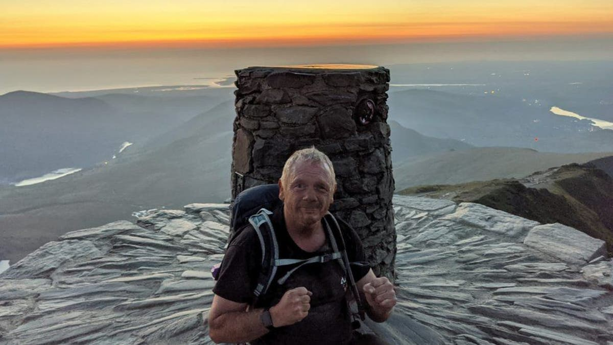 Double amputee conquers Mount Snowdon crawling on hands and knees
