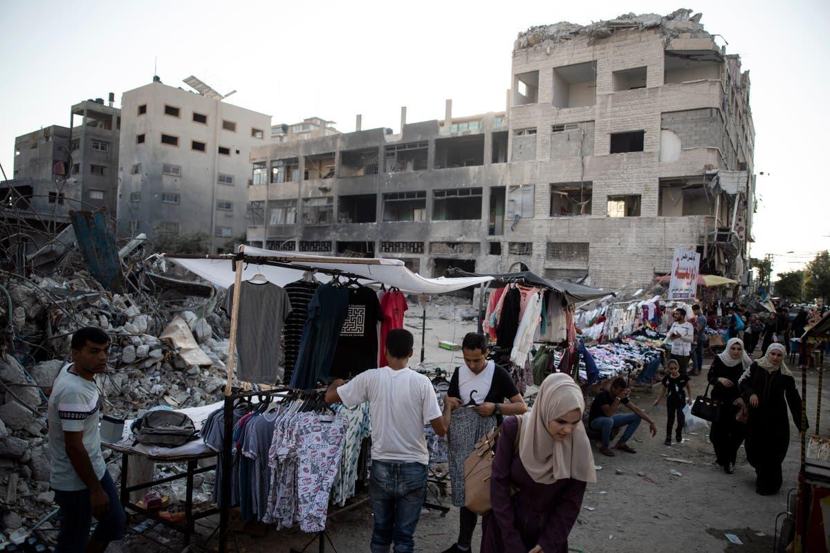 Israel lets building goods into Gaza, easing postwar closure