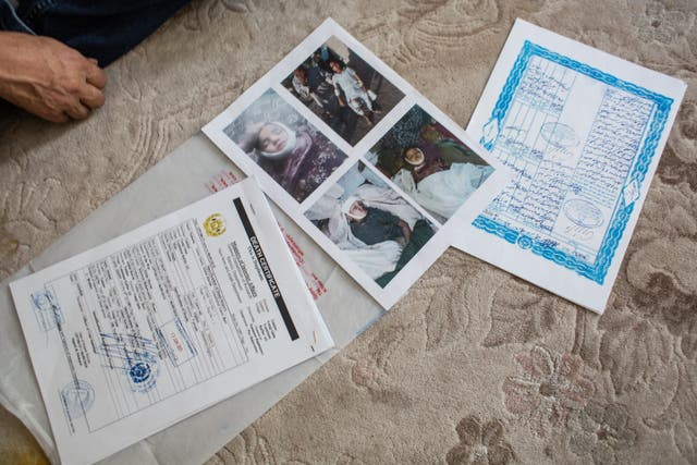 Death certificates belonging to Abdulkerim Buhri's two children he lost when a mortar hit their house in Afghanistan