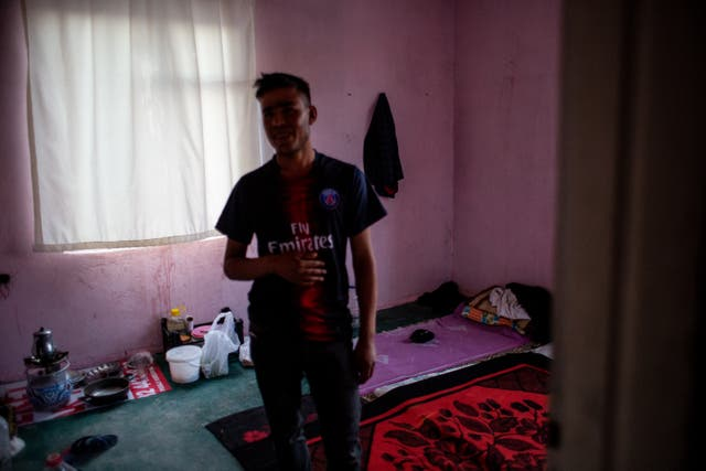 Abdullah Matin (17) an Afghan refugee, is seen in the abandoned building he shares with Dost Mohammad (21)