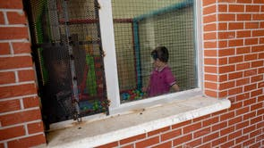 Children are seen playing in the women and families section of Van Deportation Centre, run by the Directorate General of Migration Management
