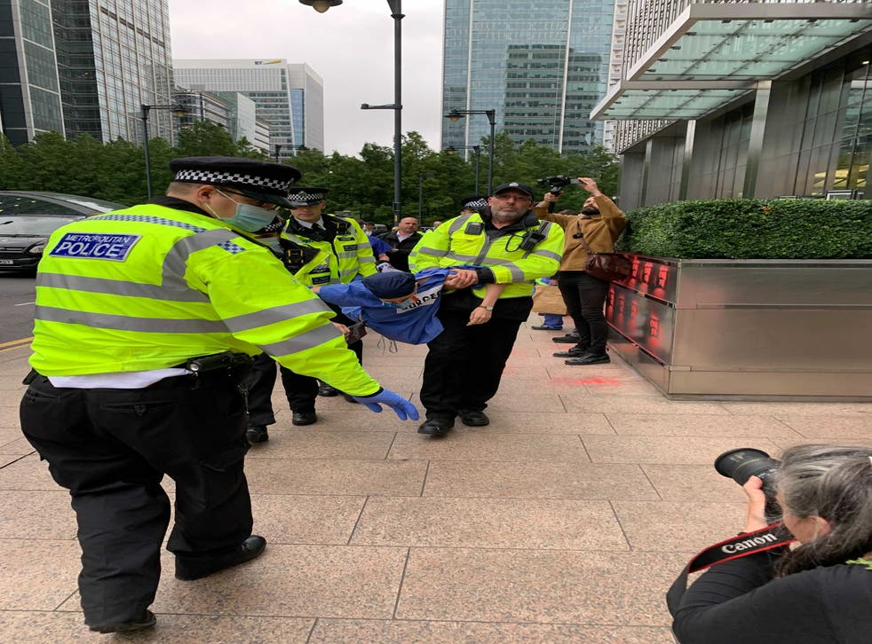<p>Police carry a protester away</p>