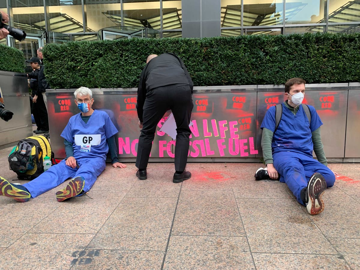 XR activists target bank HQ demanding end to fossil fuel funding – live