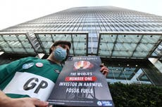 'It's my duty as a doctor': Extinction Rebellion medics glued to bank demand end of fossil fuel investment