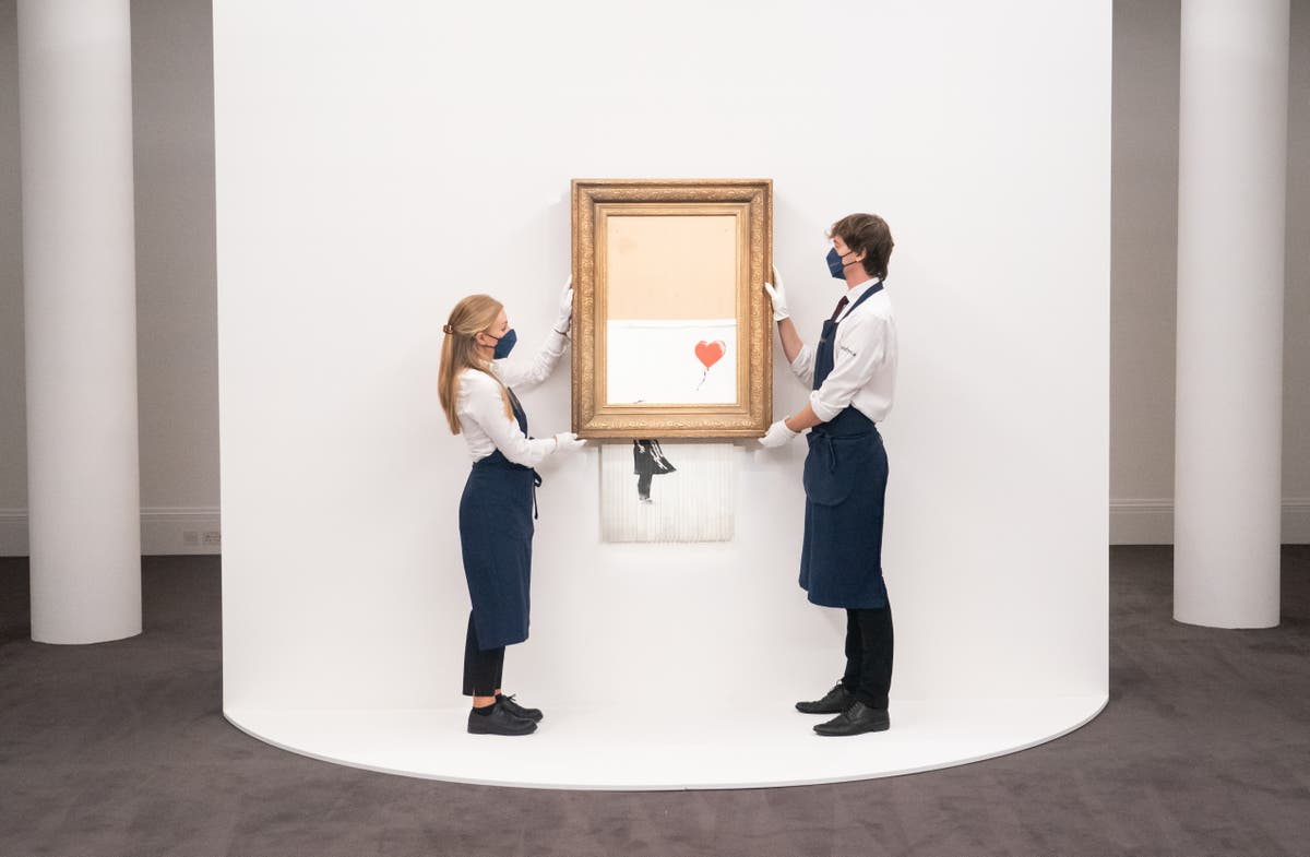 Banksy painting that shredded itself sells again – this time for £18.5m
