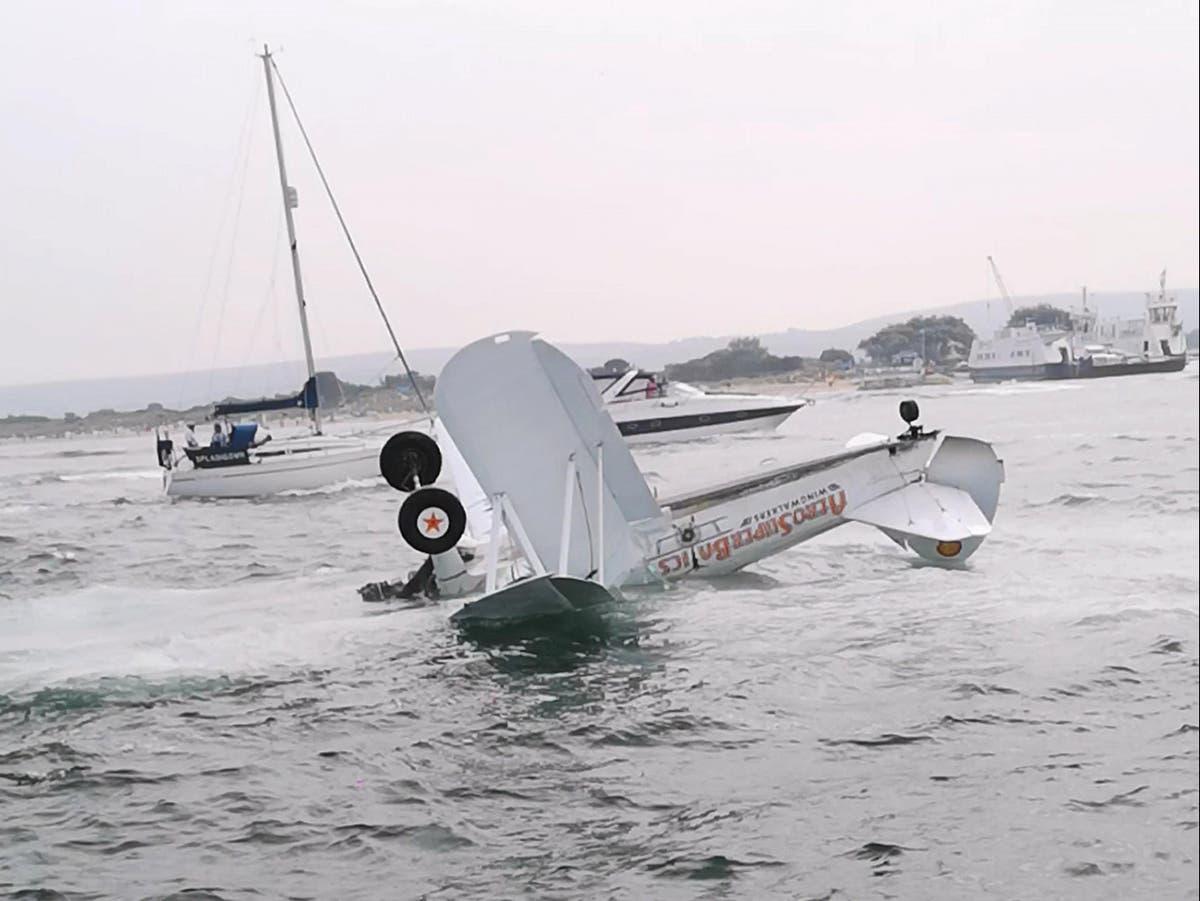 Wingwalker pilot 'deserves medal' after Bournemouth harbour crash rescue