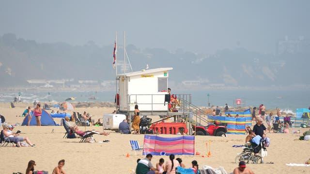 People enjoy the warm weather on Sandbanks beach, Poole
