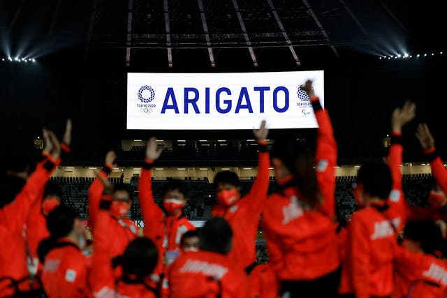 apan athletes wave as 'Thank you' in Japanese is displayed in the stadium during the closing ceremony of 2020 Paralympic Games Closing Ceremony