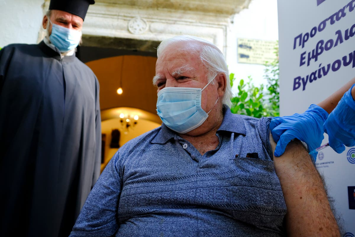 Greece begins administering COVID vaccines outside churches