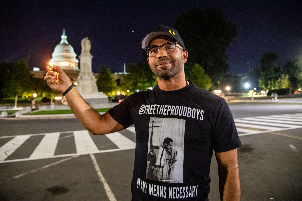 Proud Boys leader Enrique Tarrio poses with lighter against US Capitol