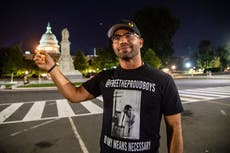 Proud Boys leader Enrique Tarrio poses holding lighter to US Capitol before starting five-month jail sentence