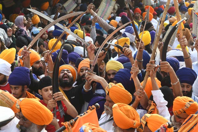 People take part in a religious procession on the occasion of the 417th anniversary of the installation of the Guru Granth Sahib, at the Gurudwara Ramsar in Amritsar