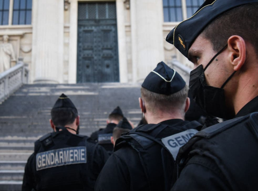 <p>French Gendarmes arrive at the Palais de Justice of Paris ahead of the start of the trial into the 2015 Paris attacks</p>