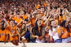 Critics slam 2021 college football season as maskless fans pack stadiums