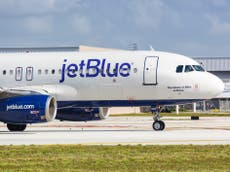 Couple banned from US airline JetBlue after refusing to wear face masks