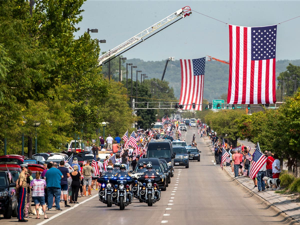 Thousands line streets across US to honour fallen Marines as remains return home