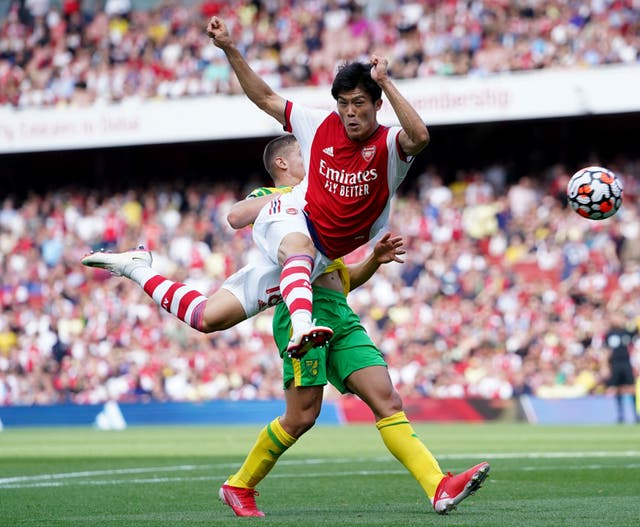 Arsenal's Takehiro Tomiyasu attempts to control the ball during the Premier League match at The Emirates Stadium