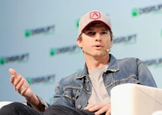 Crowds chant 'take a shower' at Ashton Kutcher during college football game