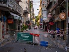 15 people fleeing Covid in Vietnam found in refrigerated truck
