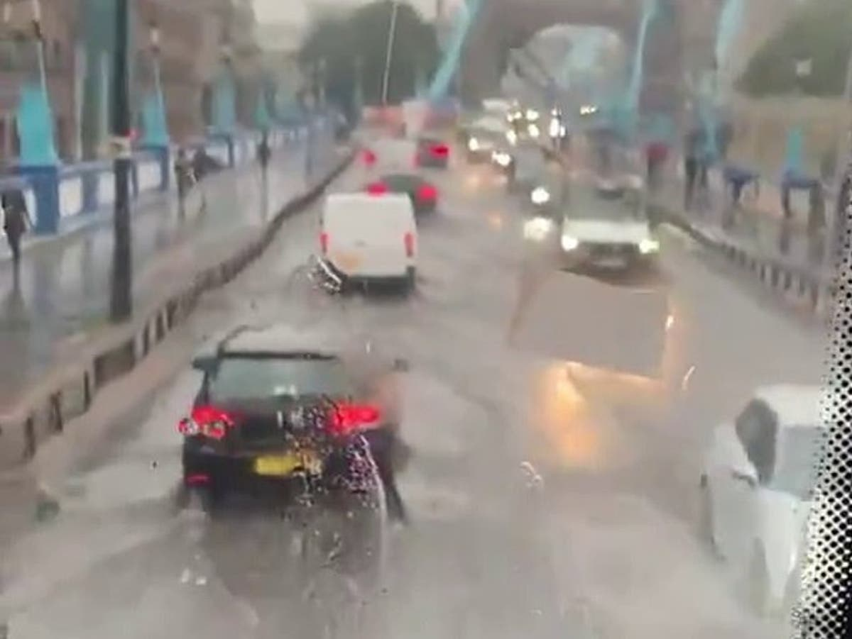 Tower Bridge floods as torrential rain lashes London