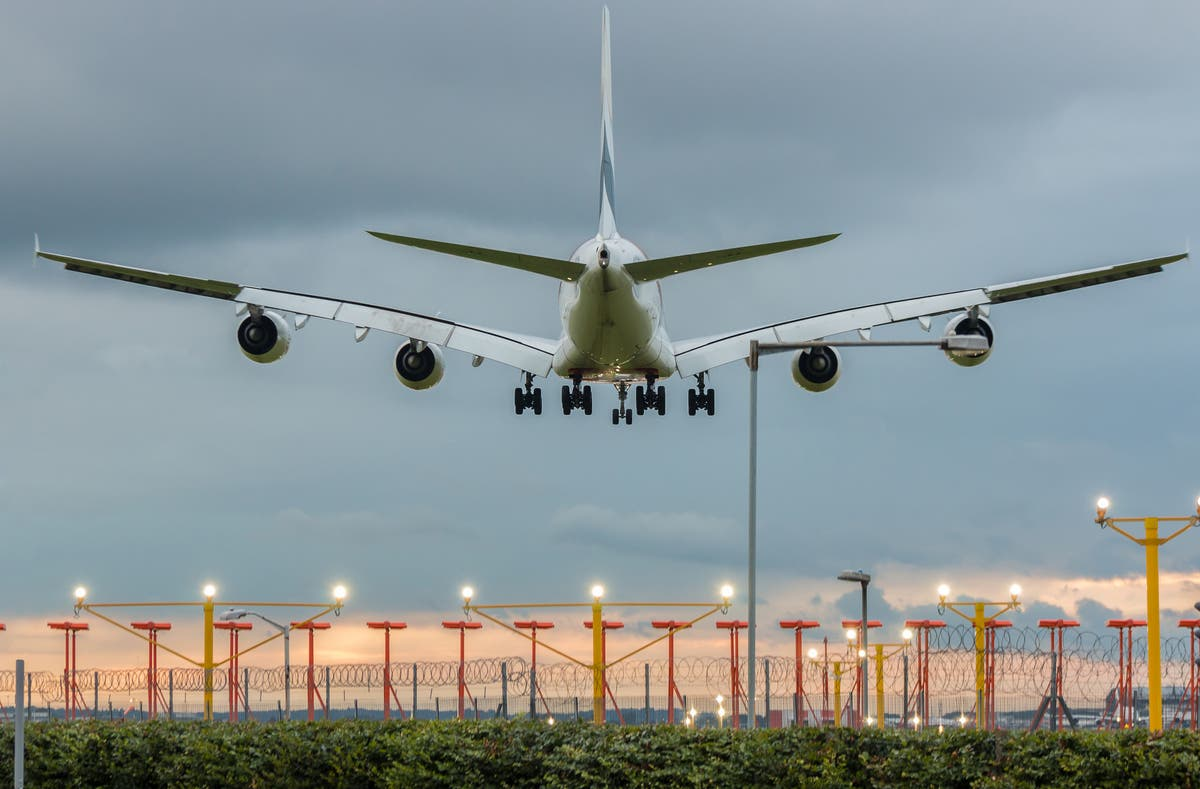 UK government claims people must keep flying to help cut carbon emissions