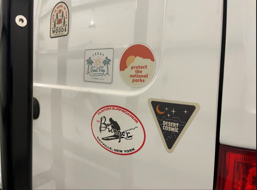 <p>Stickers on the back of the van used by Gabrielle Petito and her fiance Brian Laundrie. Mr Laundrie returned from the trip without Ms Petito, prompting a police search. </p>