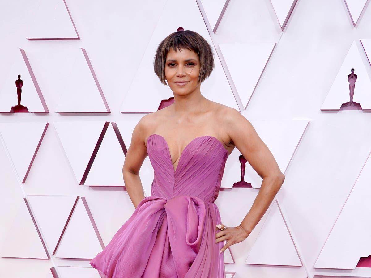 Halle Berry says it's assumed she's been 'spared hardship' because of looks