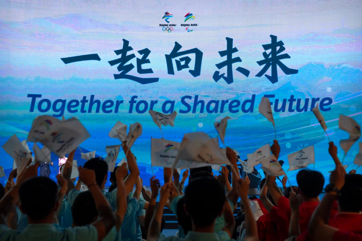 IOC urges Olympic teams to ask for Chinese vaccines