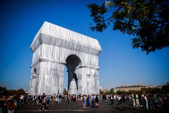 The fully wrapped Arc de Triomphe monument, as part of an art installation entitled 'L'Arc de Triomphe, Wrapped' conceived by the late artists Christo and Jeanne-Claude, is pictured on the Champs Elysees avenue in Pari