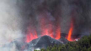 Smoke and magma rise to the sky from the volcanic eruption in El Paso, La Palma, Canary Islands