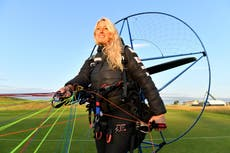 'Human swan' climate activist seriously hurt and assistant killed in paramotor crash