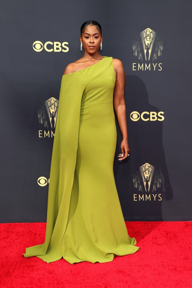 Moses Ingram in an olive green one-shoulder gown