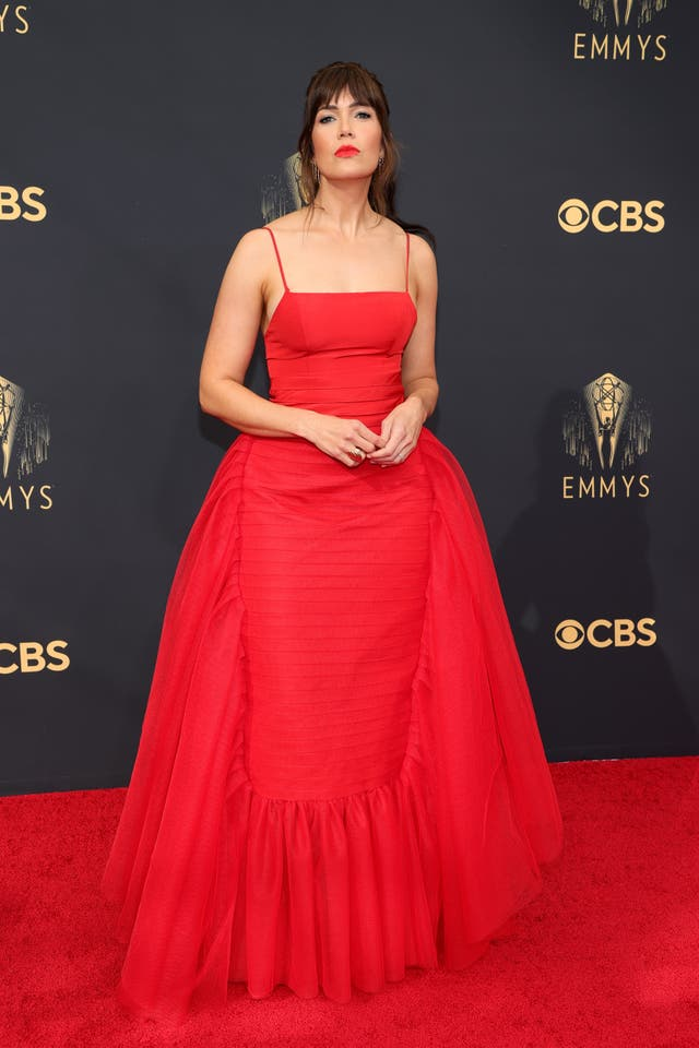 Mandy Moore wears a red Carolina Herrera gown