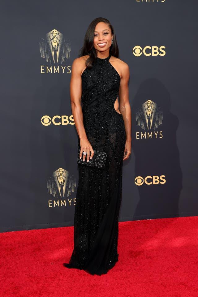 Allyson Felix wears a black embellished Reem Acra gown