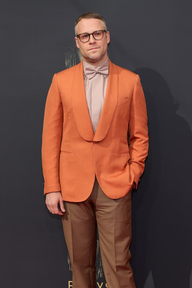 Seth Rogen in an orange blazer and brown trousers