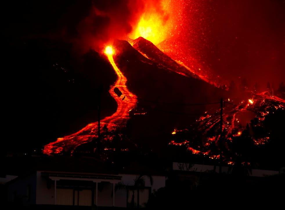 <p>Lava flows next to a house on Sunday night</s>