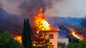 A house burns due to lava from the eruption of a volcano in the Cumbre Vieja national park at Los Llanos de Aridane, on the Canary Island of La Palma