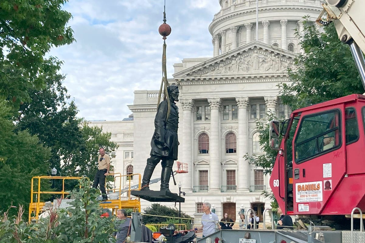 Workers reinstall Wisconsin statues downed in 2020 protest
