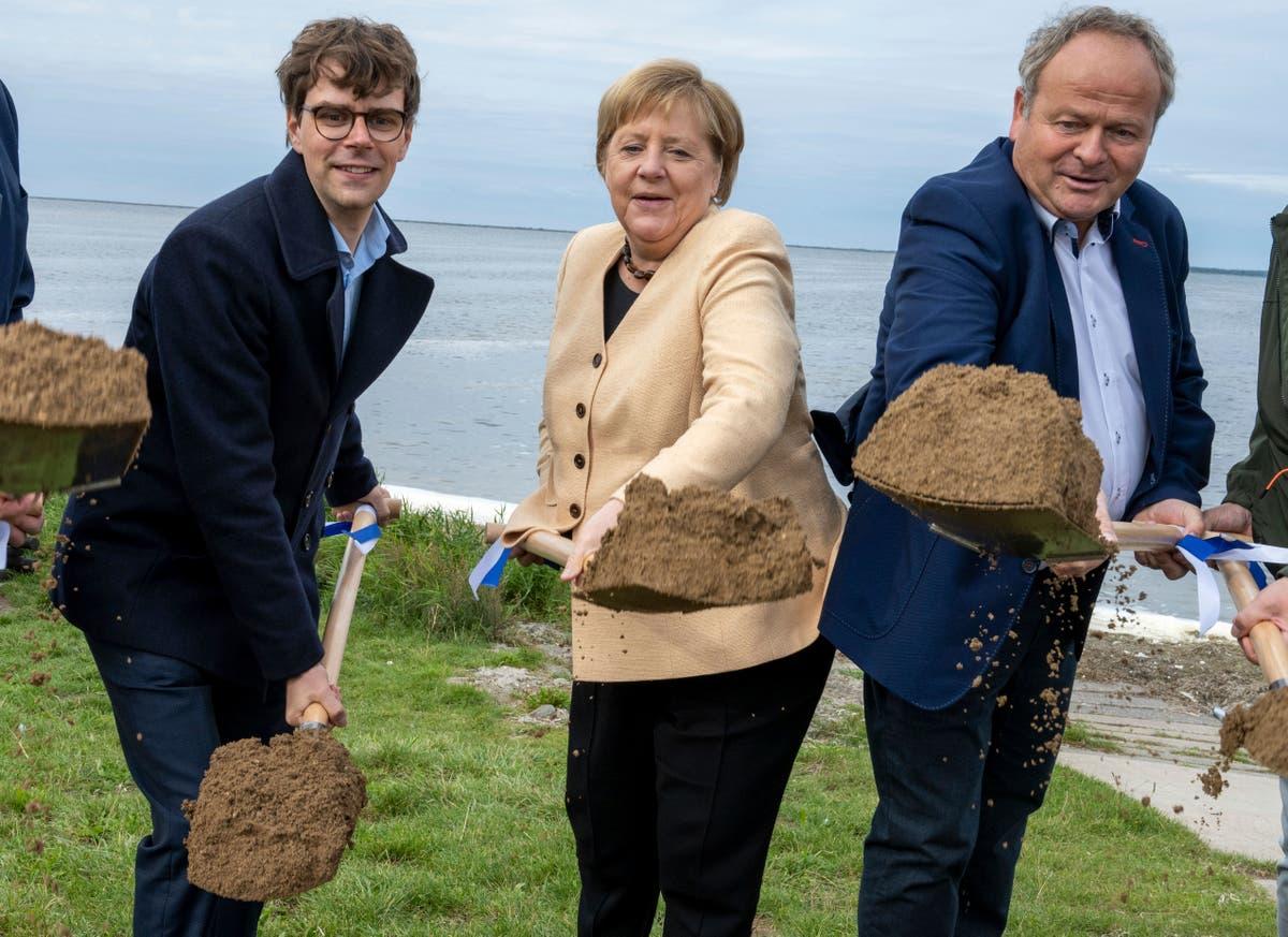 Merkel seeks to boost Laschet in close German election race