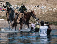 Use of horses suspended at Texas border following uproar over shocking images