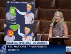 Marjorie Taylor Greene rants about China controlling Biden with giant Scooby Doo sign and cringeworthy errors