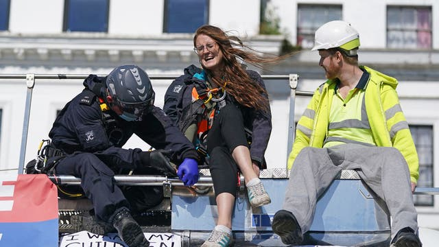 Police officers remove two protesters from the top of a tanker, as Insulate Britain block the A20 in Kent, which provides access to the Port of Dover in Kent. The environmental activists have moved location after been banned from campaigning on the M25 motorway in London