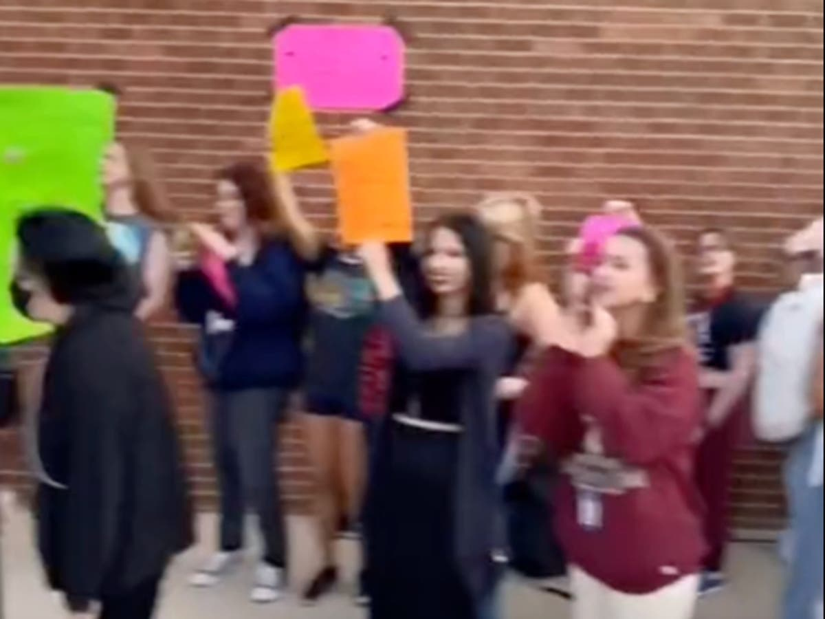 'My body is not a distraction': Thirty pupils suspended over dress code protest